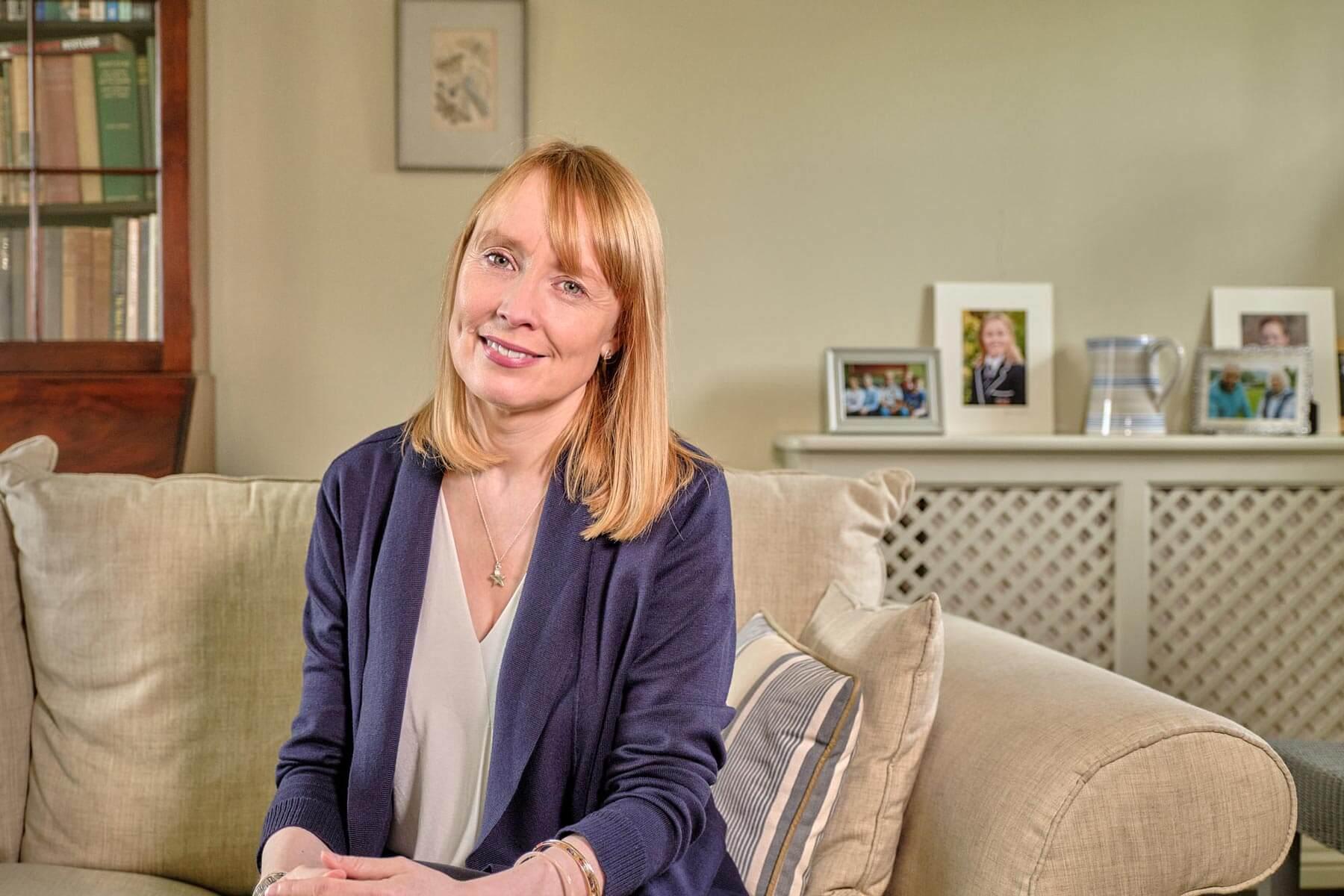 Fiona Reith Career Coach sat on sofa
