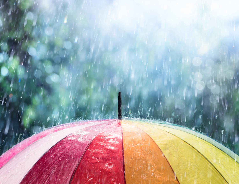 Multicoloured umbrella in the rain